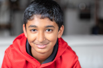 Portrait of a Smiling Young Boy with Shallow Depth of Field