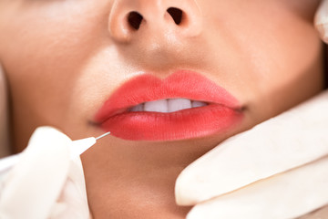 Enhancing lips appearance  on a beautiful woman