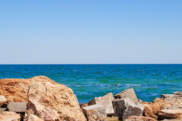 Photo of a sea landscape with a rocky beach