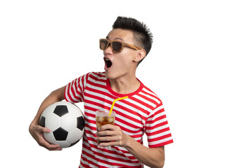 Asian people holding football and soft drink in his hand.
