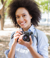 Charming Black Woman With Retro Camera In Nature