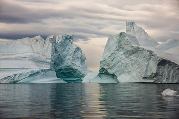 Poster Arctic massive Icebergs floating in the fjord scoresby sund, east Greenland
