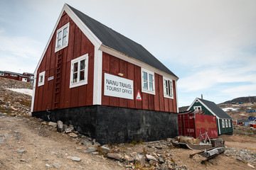 tourist office of Ittoqqortoormiit with colorful houses, eastern Greenland at the entrance to the Scoresby Sound fjords