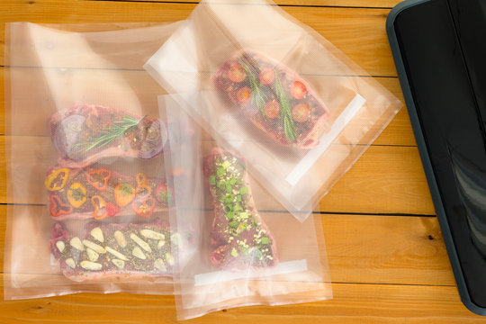 Three vacuum packed bags of flat iron steaks