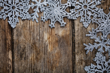 Christmas  snowflakes on a wooden background