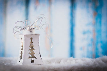 White lantern with Christmas tree décor and on blue background