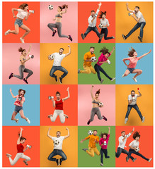 Forward to the victory.The young women and men as soccer football players jumping and kicking the ball at studio on a red background. Football fan and world championship concept. Human emotions