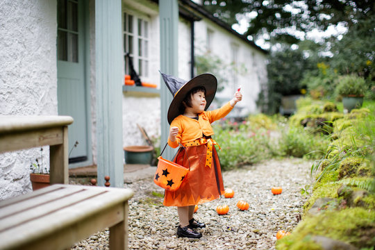 Toddler girl pretend playing Halloween party