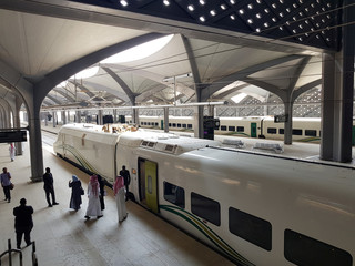 Saudi people board at the new KAEC station of the Haramain speed train at King Abdullah Economic City, near Jeddah