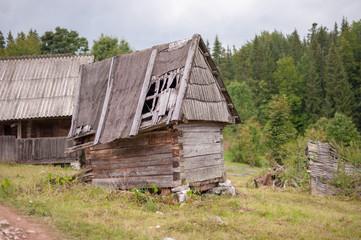Little wooden storage hut in damaged condition