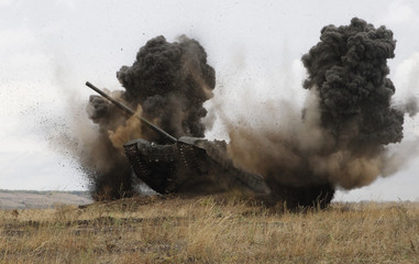 A T-72B tank, operated by servicemen of the self-proclaimed Lugansk People's Republic, drives during military exercises at a target range in Luhansk Region