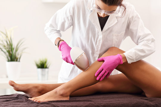 Adult woman having laser hair removal in professional beauty salon