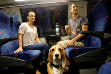 Passengers and a dog travel on Israel's new high-speed rail line from Jerusalem to Ben Gurion International Airport