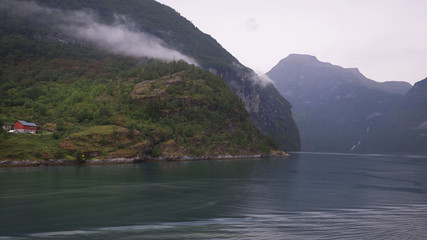 Solitary part of Geiranger village, at the end of the UNESCO-protected Geiranger fjord, one of Norway's most popular natural attractions, surrounded by steep cliffs and waterfalls