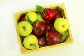 Ripe red and green apples in wooden box. White background.