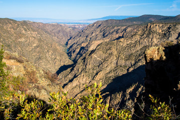 Long view of Black Canyon of the Gunnison National Park, including the Gunnison River, which carved this amazingly deep canyon in Colorado.