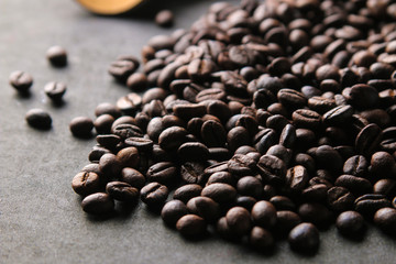 Roasted coffee beans close-up. mixture of arabica and robusta on a black background