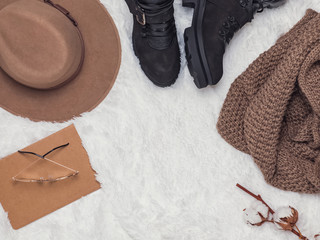 Boots , hat and warm knitted scarf top view