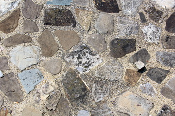 Various background types of laying stones from granite and other materials used in the construction of old buildings and structures.