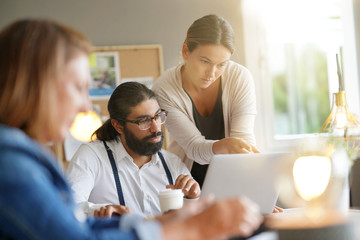 Start-up people working together in office