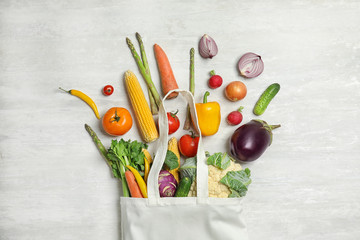 Flat lay composition with fresh vegetables on light background