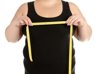 Overweight woman with measuring tape on white background, closeup
