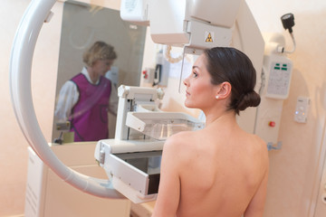 female patient undergoing mammography test in hospital