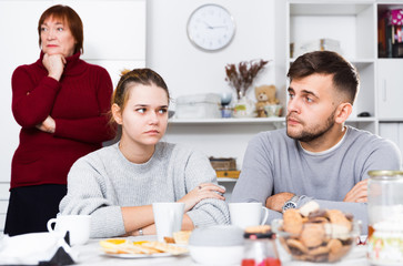 Upset guy and girl after discord with mother