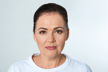 Portrait of beautiful older woman on white background