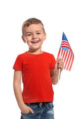 Little boy with American flag on white background