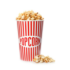 Carton cup with delicious fresh popcorn on white background