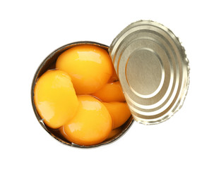 Tin can with conserved peach halves on white background, top view