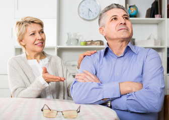 Husband and wife arguing with each other and try to resolve family conflict at table
