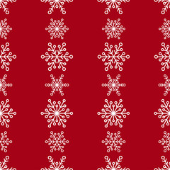 Winter seamless pattern with lines of white snowflakes on red background.