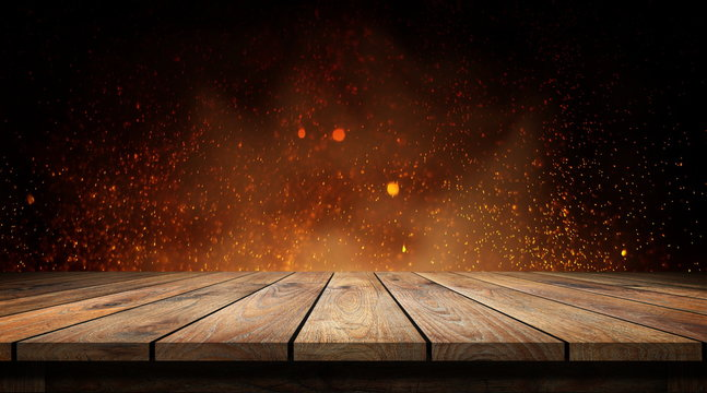 Wood table with flame effect on dark background.