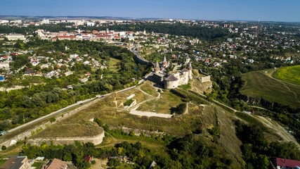 Aerial view of old fortress. Stone castle in the city of Kamenets-Podolsky. Beautiful old castle in Ukraine.