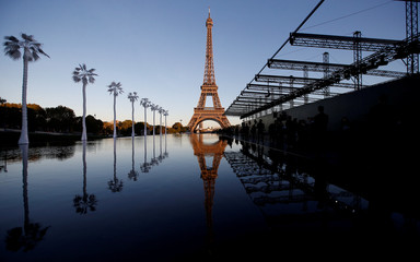 The Eiffel Tower is pictured before the fashion house Saint Laurent's show during Paris Fashion Week in Paris