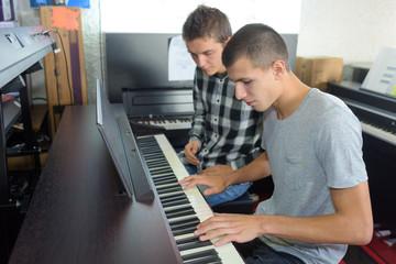 Young man playing keyboard