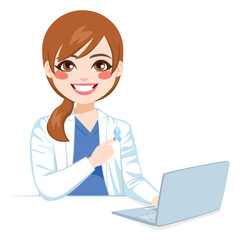 Young female doctor pointing blue ribbon prostate cancer awareness concept working on laptop