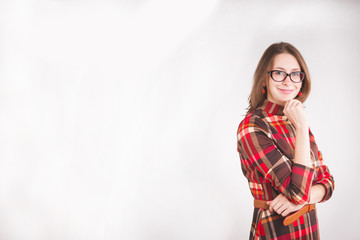Happy business women in glasses standing and smiling, over grey background, Studio , free space , advertising , promo standing women concept , red dress, in glasses, design