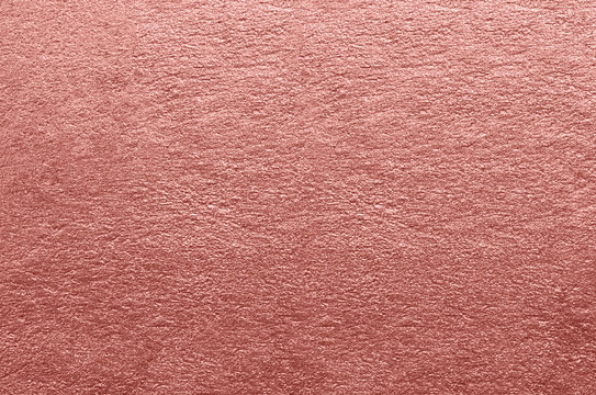 Abstract background. Rose Gold foil texture.