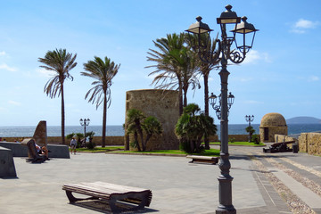 Enjoying the promenade at the city of Alghero next to the Mediterranean Sea, Sardinia, Italy
