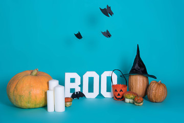 Halloween holiday background with pumpkins on blue background. View from above.