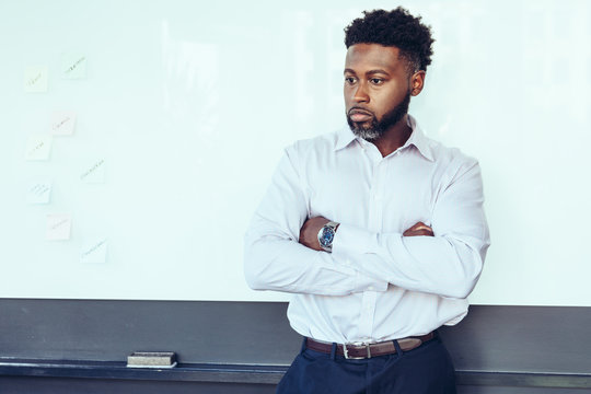 Thoughtful businessman standing in office