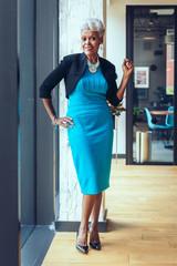 Portrait of senior businesswoman standing in office