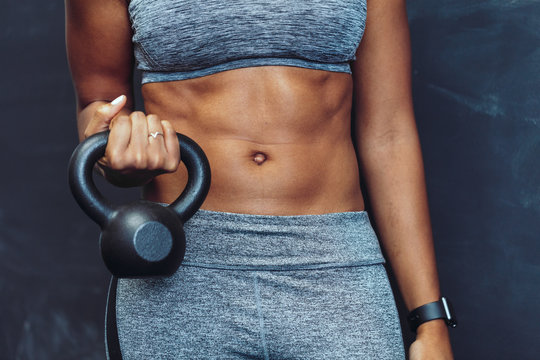 Close up of woman exercising with kettlebell