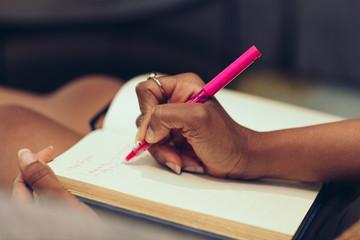 Woman hand writing on diary