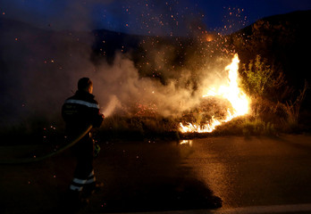 A firefighter tries to extinguish a fire in Orebic