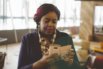 Businesswoman using smartphone in the office