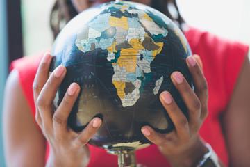 Woman hand holding globe
